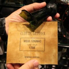 $77,000 Cognac Bottle falling from a table